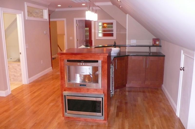 Bar with build in microwave and coffee maker.
